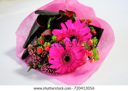 https://thumb1.shutterstock.com/display_pic_with_logo/167494286/720413056/stock-photo-pink-flowers-bouquet-720413056.jpg