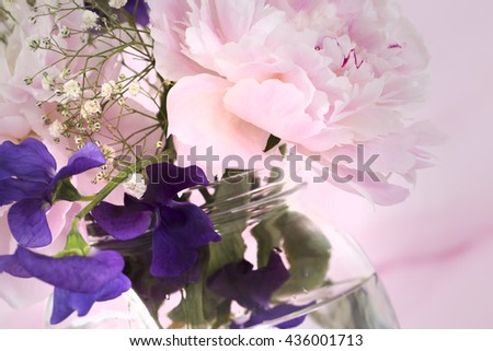 Pink Flowers in a vase, isolated against pink