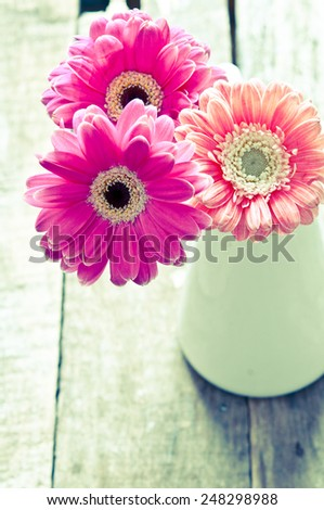 Pink flowers in vase/retro filter - stock photo