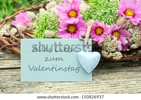 pink flowers with valentines day card/valentines day/flowers
