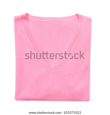 Pink folded woman knitted blouse on white isolated