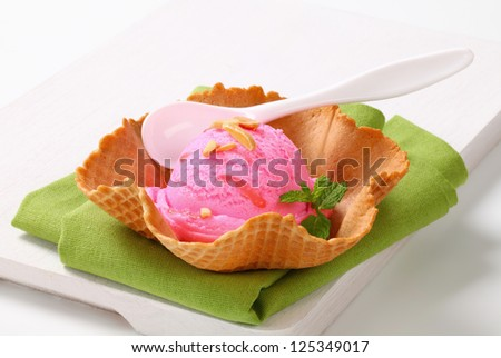 Pink fruit flavored ice cream in a waffle basket