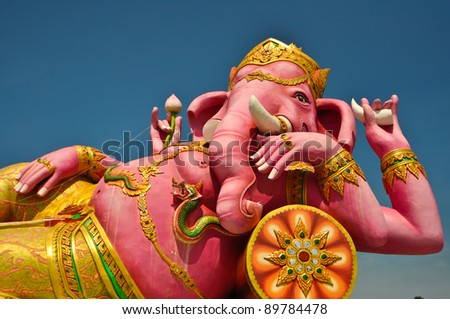 Pink ganecha statue in relaxing protrait on blue sky,Wat Samarn in Chachoengsao Thailand. - stock photo