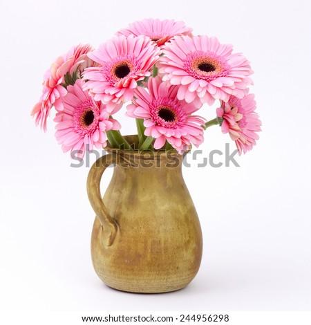 pink gerbera flowers in a vase - stock photo