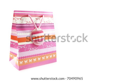 Pink gift bag isolated on white background - stock photo