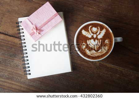 Pink Gift box coffee and blank notepad on wooden background - stock photo