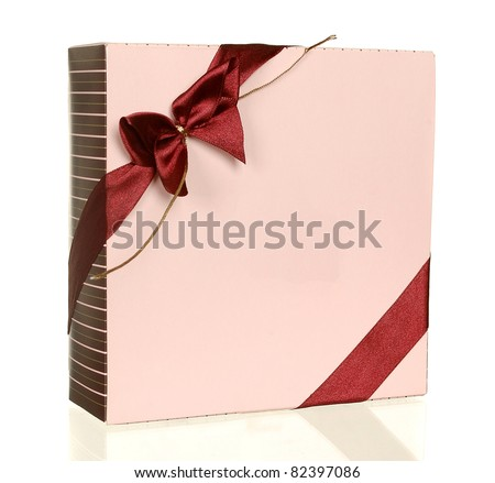 Pink gift box with a red bow isolated on a white background - stock photo