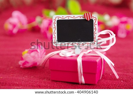 Pink gift box with signboard - stock photo