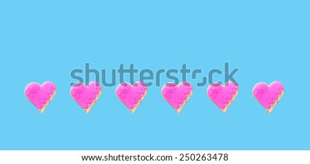 Pink  Gingerbread hearts Isolated on blue  background - stock photo