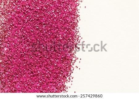 Pink glitter on light background - macro photo - stock photo