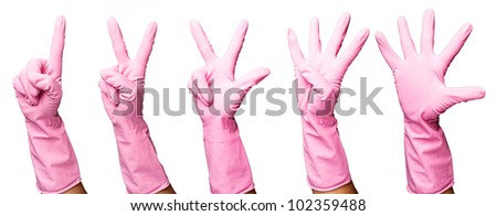 pink gloves gesturing numbers over a white background - stock photo