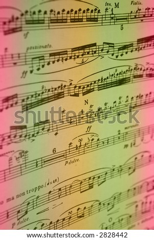 Pink gold and green rainbow colored sheet music background