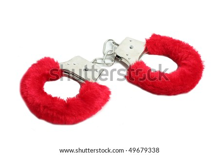 Pink handcuff isolated