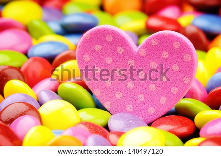 Pink heart and colorful candy. Love concept - stock photo