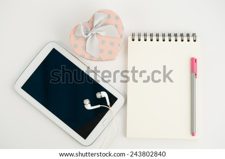 Pink Heart gift box tablet and note book pen on white background - stock photo