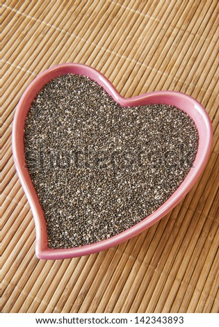 Pink heart shaped dish of chia seeds