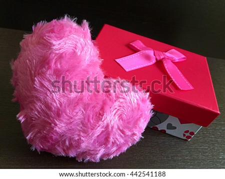 Pink hearts,  gift box and greeting card on  wooden background. Valentines day or Woman day concept.  Copy Space