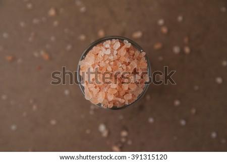pink himalayan salt on wooden  - stock photo