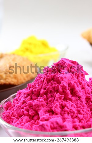 pink holi colors in glass bowl - stock photo
