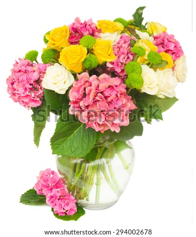 pink hortensia flowers with white and yellow roses in vase  isolated on white background