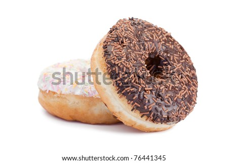 Pink iced and chocolate donuts on a white background - stock photo