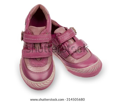 Pink kid's boots isolated.