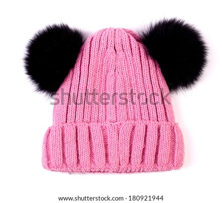 pink knitted wool children hat isolated - stock photo