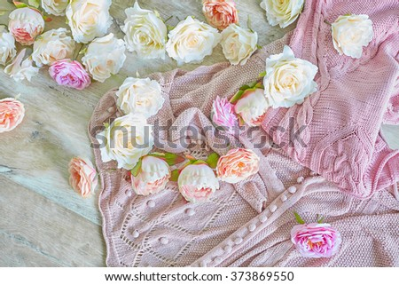 pink knitting wool with flowers on a wooden texture - stock photo