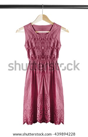 Pink lacy dress on wooden clothes rack isolated over white - stock photo