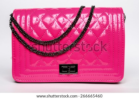 Pink lady's bag with black chain on a white background - stock photo