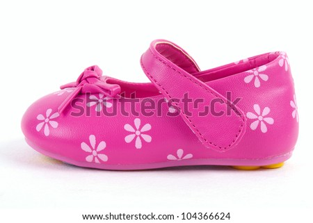 Pink leather baby shoe on white background - stock photo