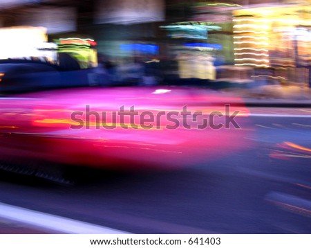 Pink limo in motion - stock photo
