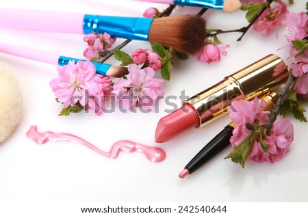 Pink lipstick and flowers  - stock photo