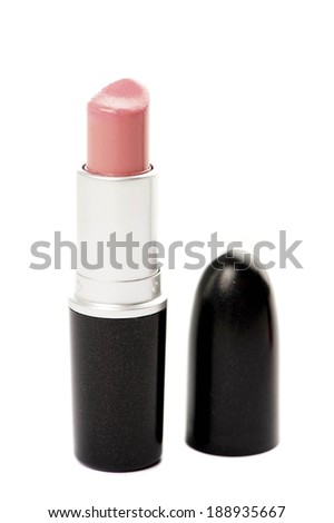 Pink lipstick and lid isolated on a white background