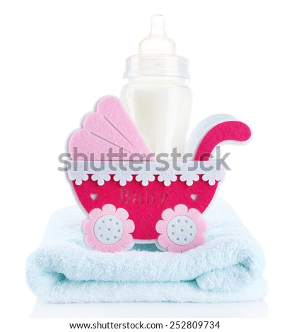 Pink little pram and bottle of milk isolated on white - stock photo