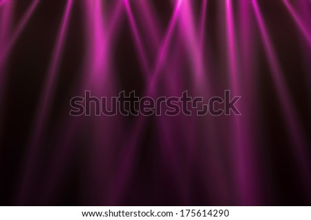 pink luminous rays on a dark background - stock photo