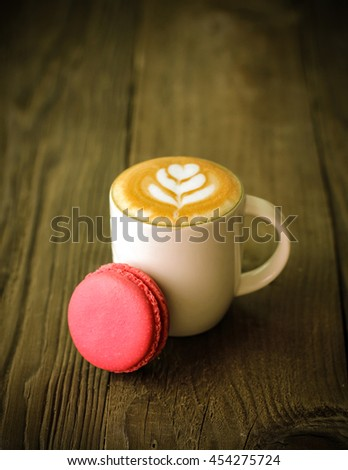 Pink macaroon and piccolo latte - stock photo