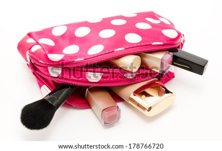 Pink make up bag with cosmetics isolated on a white background - stock photo