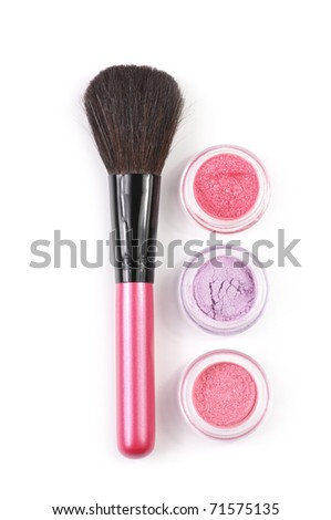 Pink make-up brush and powder eye shadows in jars isolated on white background. - stock photo