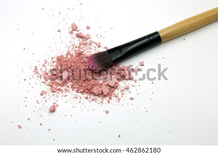 pink makeup powder and brush on white background