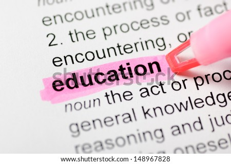 Pink marker on education word  - stock photo