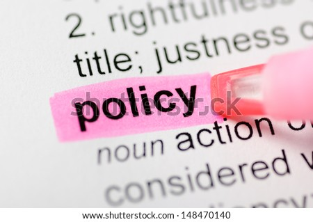 Pink marker on policy word  - stock photo