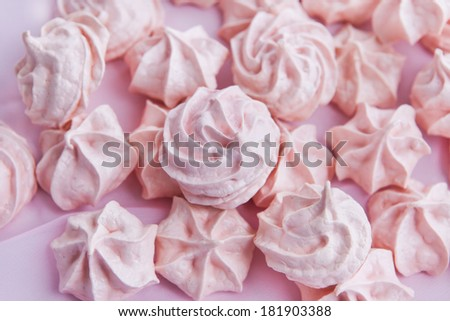 Pink meringues on a pastel background