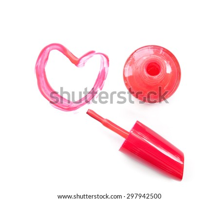 Pink nail polish and brush draw heart shape on white background - stock photo