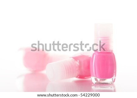 pink nail polish bottles on white background