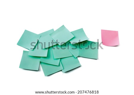 Pink note on green ones - stock photo