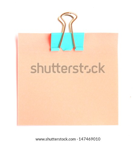 Pink Note paper with paper clip on white background. - stock photo