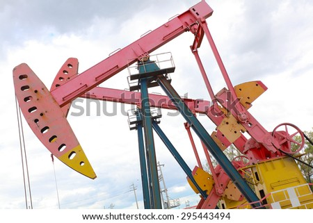 Pink Oil pump oil rig energy industrial machine for petroleum crude of countryside,dirt road - stock photo