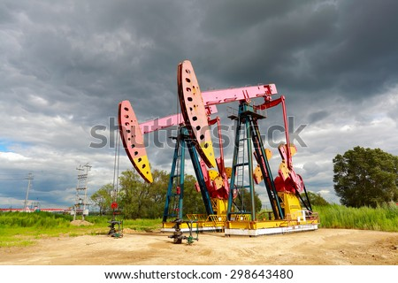 Pink Oil pump oil rig energy industrial machine for petroleum crude of countryside dirt road - stock photo