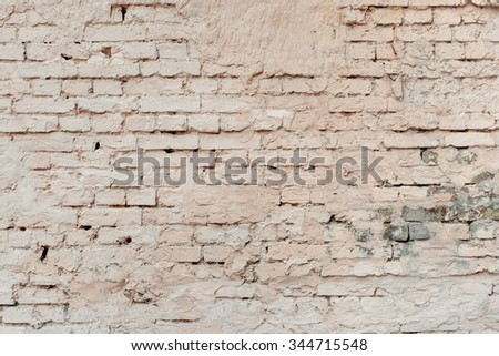 Pink old worn brick wall texture background. - stock photo